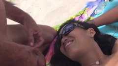 Young Asian wife having sex at public beach