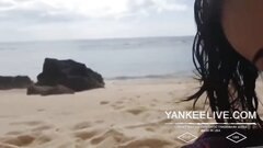 Beautiful Asian wife doing oral sex at the beach