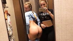 Two blonde Russian babes kiss and fuck in public store dressing room
